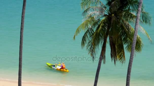 896b839c5f Two woman rowing in canoe on the sea. Thailand — Stock Video ...