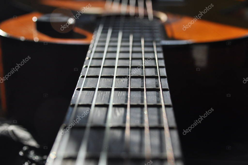 Classical guitar  Issuing a stringed instrument sounds  Fretboard