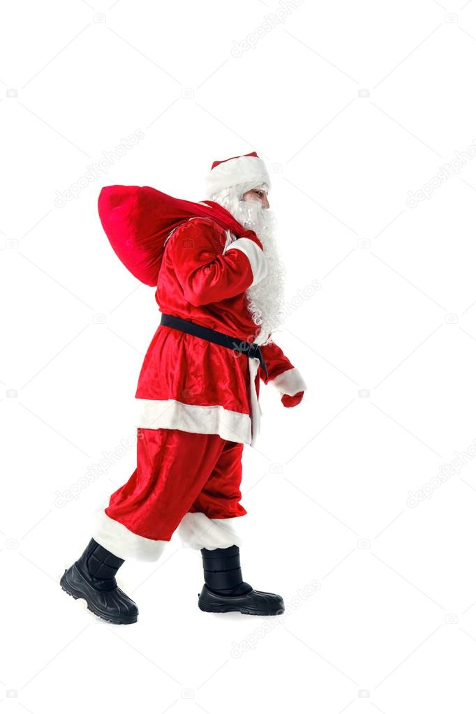 Der Nikolaus Trägt Einen Sack Mit Den Geschenken Stockfoto