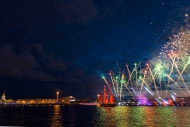 Colorful fireworks and a ship with scarlet sails.
