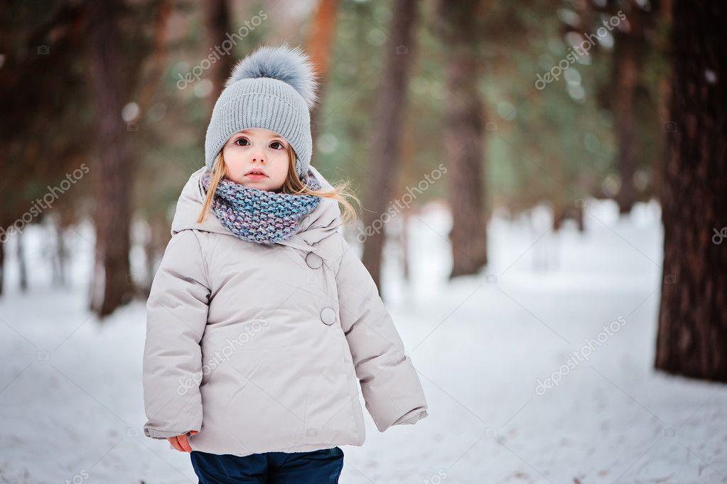 355aac7a3b1f winter portrait of cute baby girl walking outdoor in snowy forest in ...