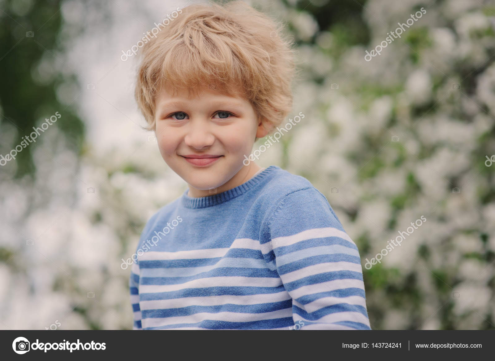 Adorable Blonde Kid Boy Portrait In Blooming Cherry Garden Walking