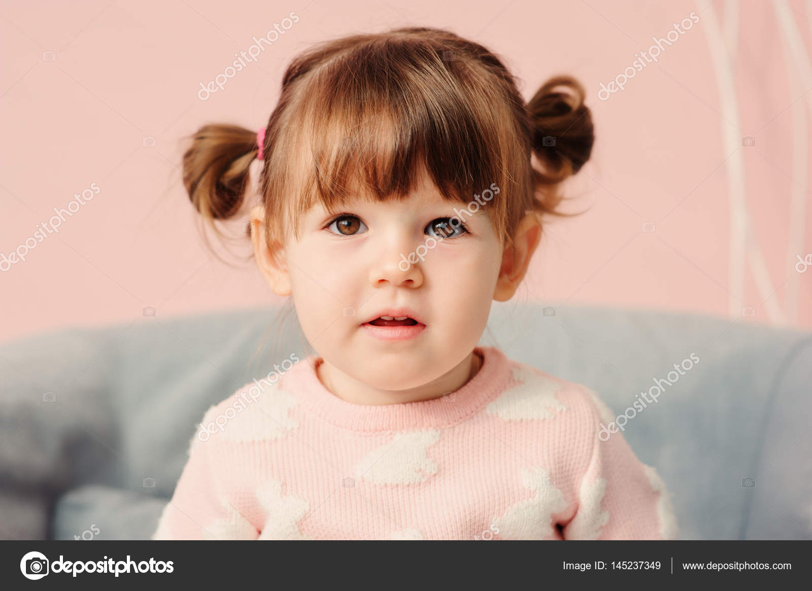 fc12618c804e Close up indoor portrait of cute happy 2 years old baby girl in pink  sweater– stock image