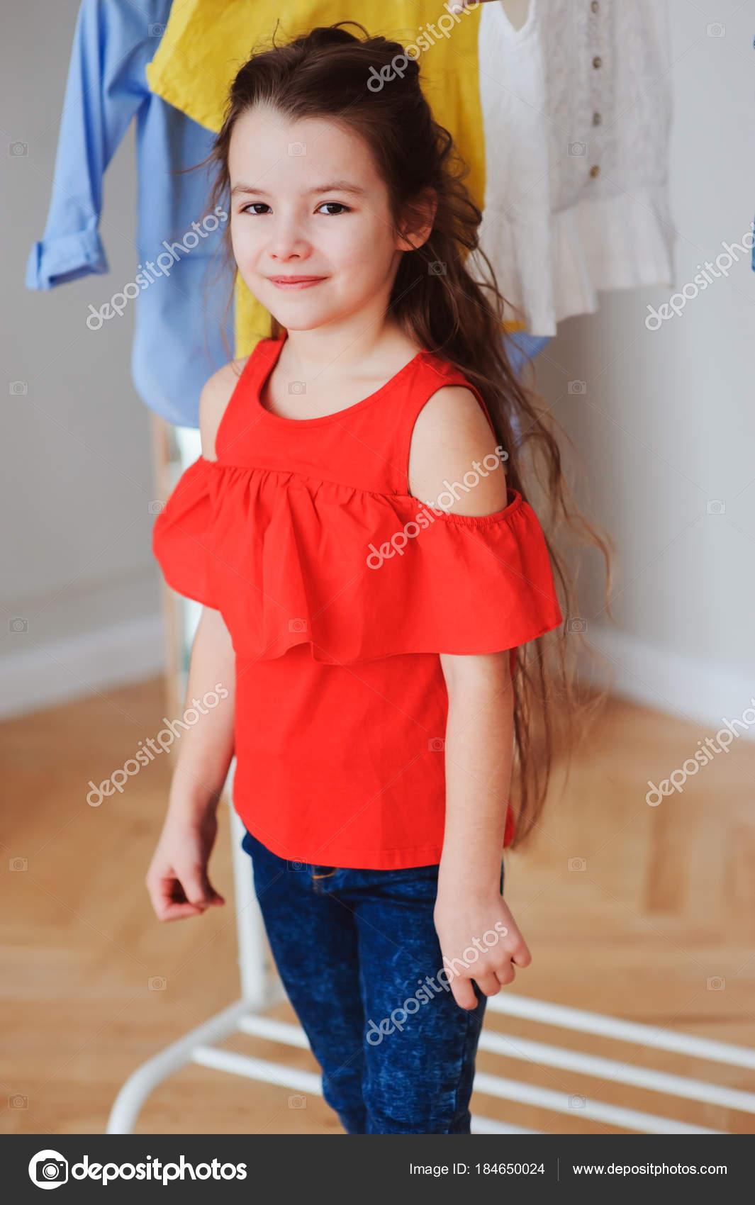 bb0ce2e169db Cute Little Child Girl Choosing New Modern Clothes Her Wardrobe ...