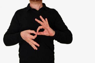 Sign language interpreter man translating a meeting to ASL, American Sign Language. Empty copy space