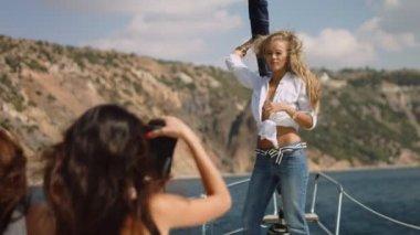 Sexy girls making photo on yacht