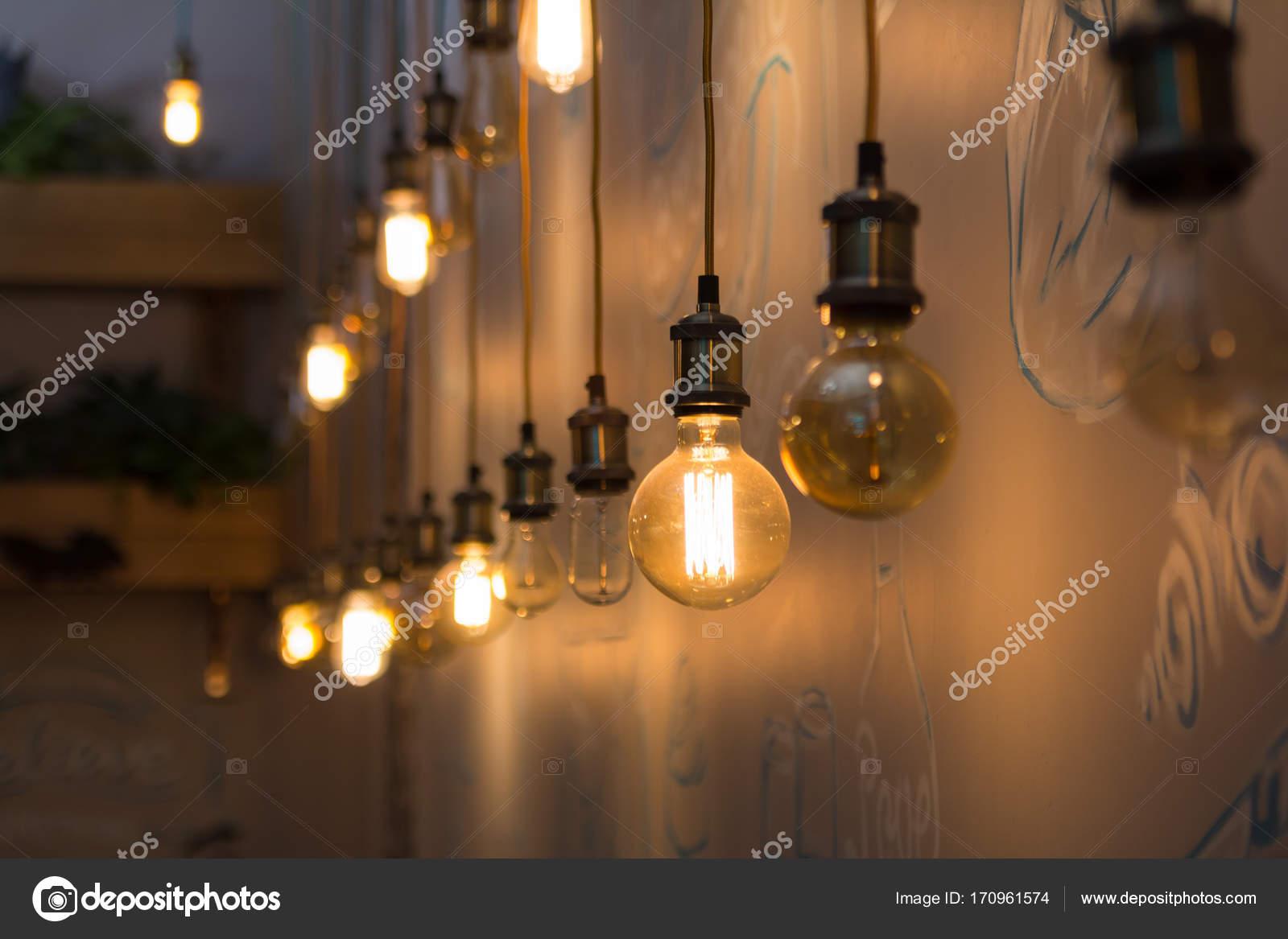 vintage style light bulbs in interior of restaurant stock photo