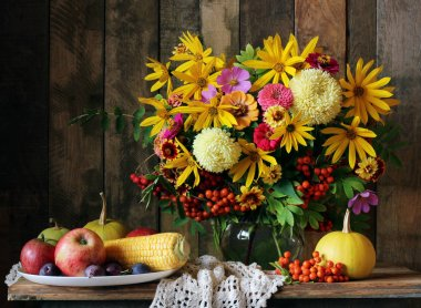 autumn still life with bouquet, fruit and vegetables