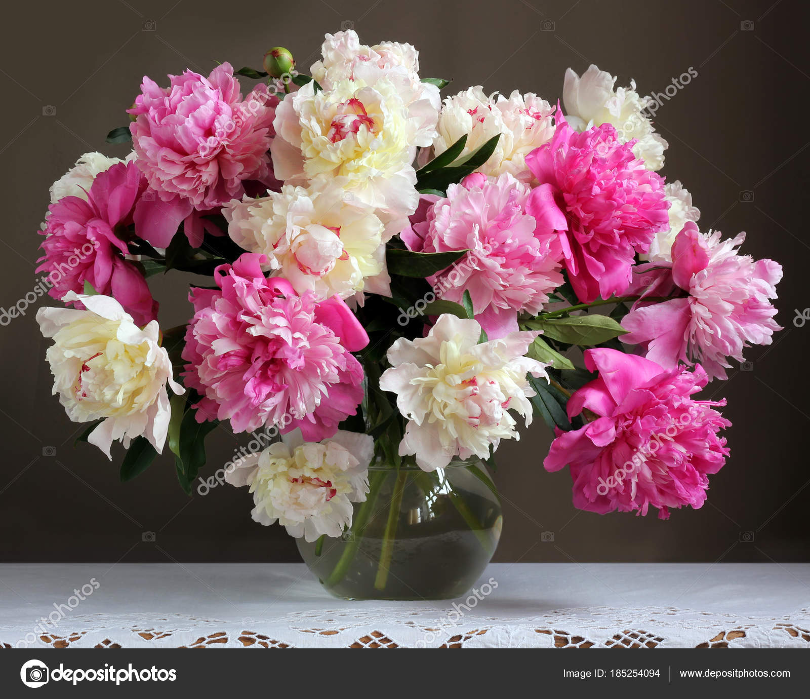 Peonies In A Jug On The Table Bouquet Of Garden Flowers Stock