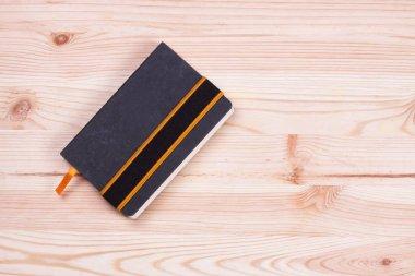 Notebook on wood desk