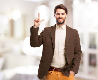 happy businessman with loser sign