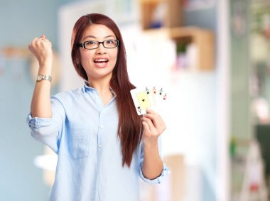 happy chinese woman with poker cards