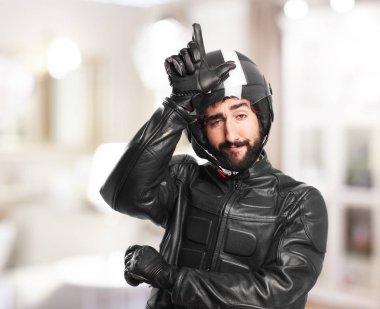 happy biker with loser sign