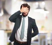 Fotografie traurigen Geschäftsmann Abdeckung Augen