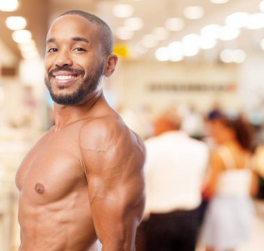 happy black man in strong pose