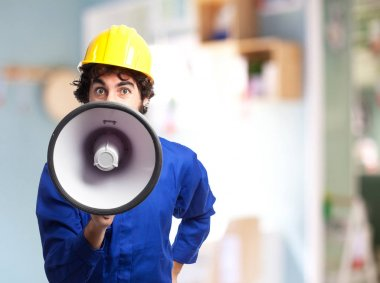 angry worker man with megaphone