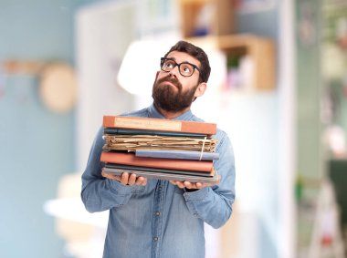 stressed young man with files