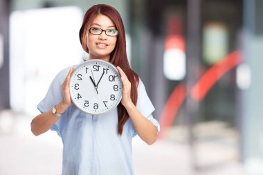 happy chinese woman with clock