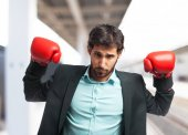 Fotografie angry businessman in boxing gloves
