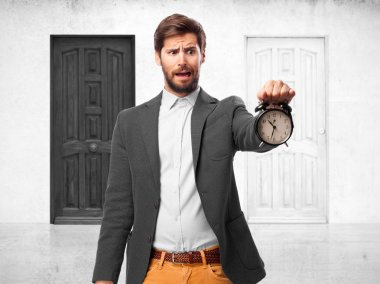 worried businessman with clock