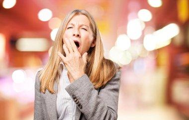 senior beautiful woman yawning