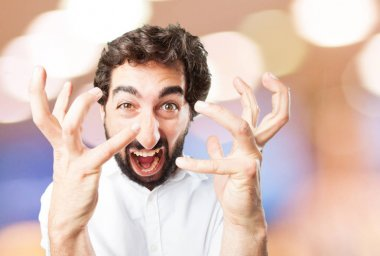 young funny man in angry pose