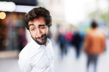 young funny man in success pose