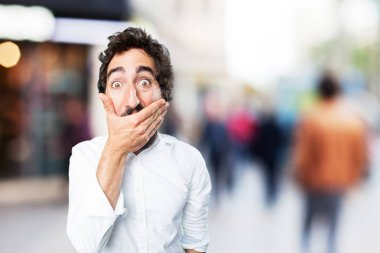 young funny man covering mouth