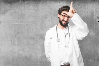 young funny doctor in loser pose