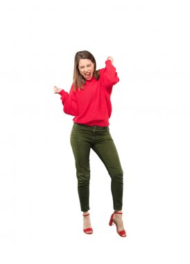Young pretty woman dancing. Full body cutout person against white background.