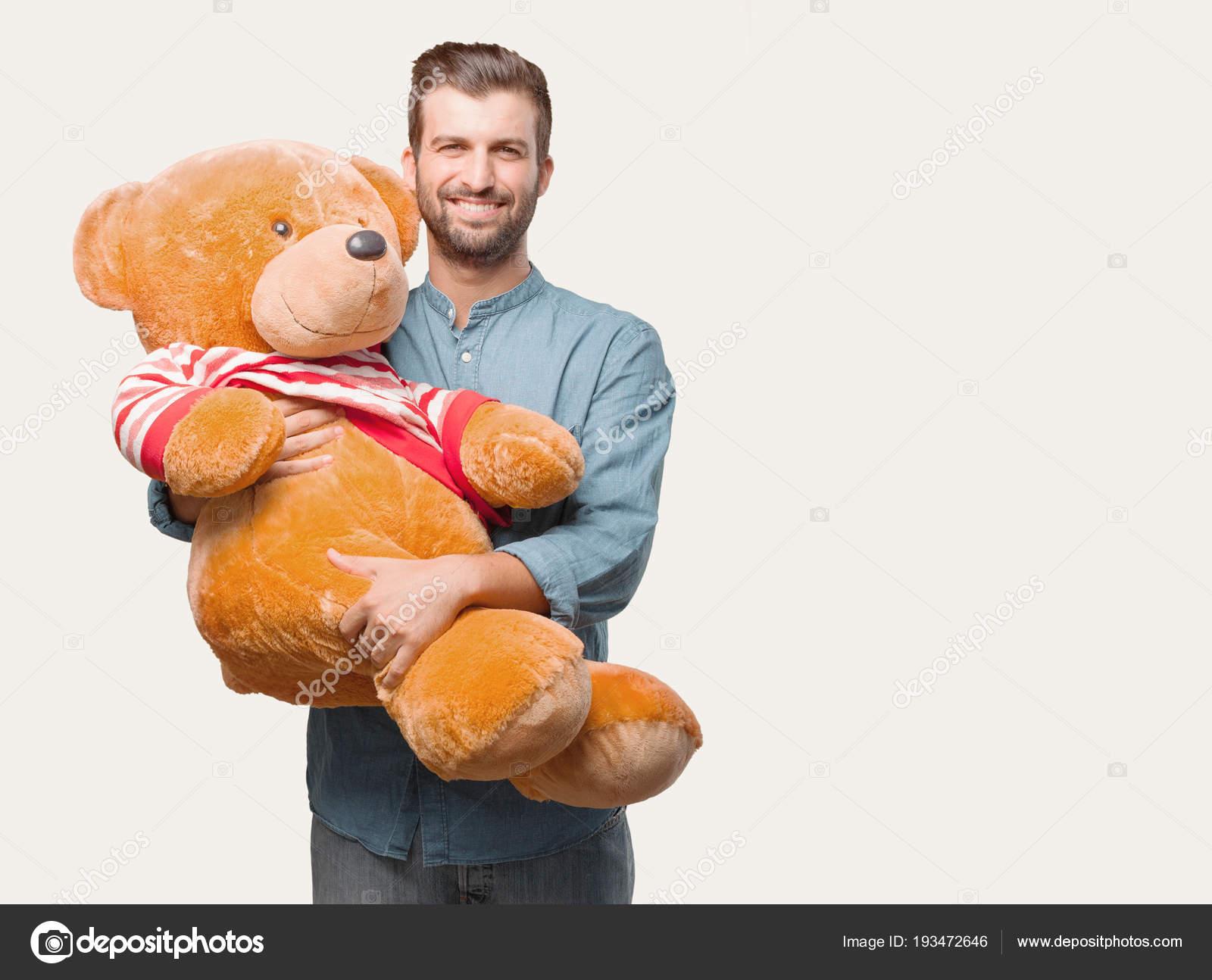 Bear kissing man