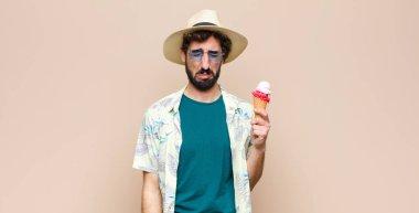 young tourist man having an ice cream