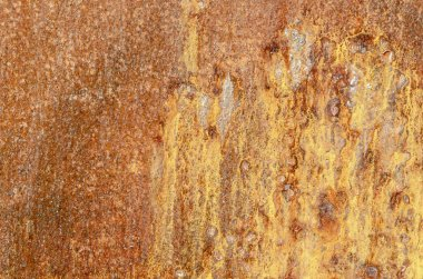 Rusty slab of fishing boat hull weathered by salt water