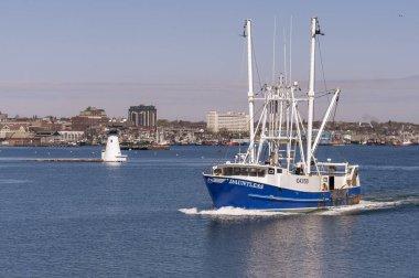 New Bedford, Massachusetts, USA - April 25, 2020: Commercial fishing boat Dauntless, hailing port Cape May, NJ, leaving New Bedford