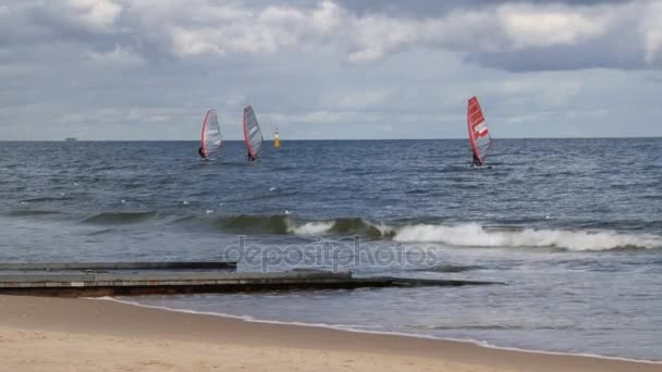 People windsurfing in Sopot, Poland.