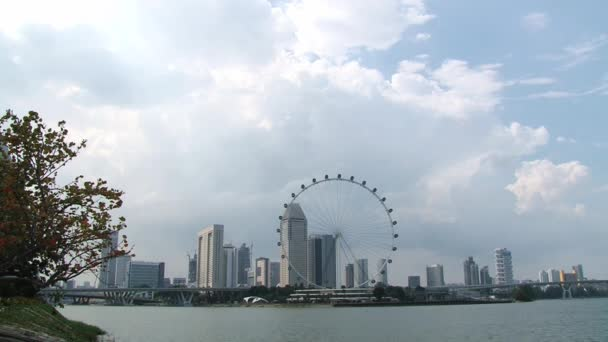 View to the skyline of the city with the Singapore Flyer gian Ferris wheel in Singapore, Singapore.