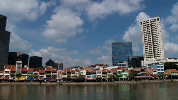 View to the modern and historical quay buildings at the river bank in Singapore, Singapore.