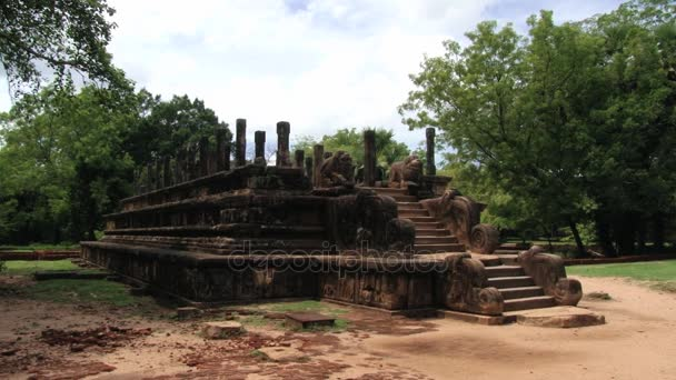 Tourist visits ruins of the temple in the ancient city of Polonnaruwa, Sri Lanka.