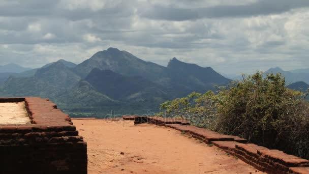 View to the ruins of the palace at the ancient Sigiriya rock fortress in Sigiriya, Sri Lanka.