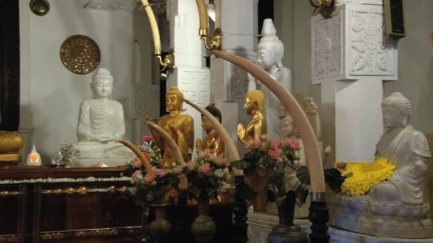 View to the Buddha statues in  the Temple of Tooth (Dalada Maligava) in Kandy, Sri Lanka.
