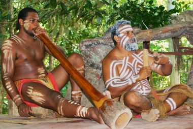 Aborigine actors perform music with traditional instruments in the Tjapukai Culture Park in Kuranda, Queensland, Australia.