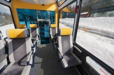 Interior of the second class car in the train of Matterhorn Gotthard Bahn between Brig and Zermatt.