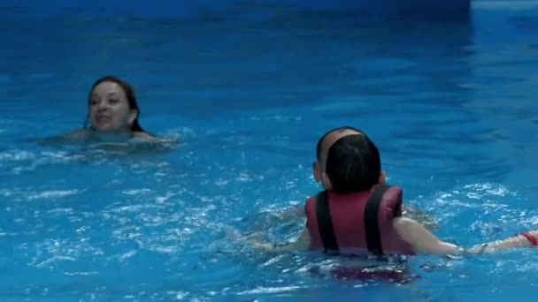 Family Swimming in the Pool at Slow Motion.