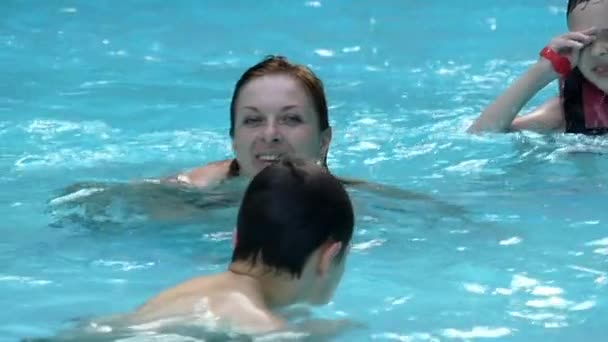 Mother and Two Boys Swimming in the Pool.