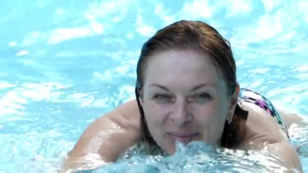Happy Woman Resting in an Artificial Basin in Which Are Waves. Slow Motion.