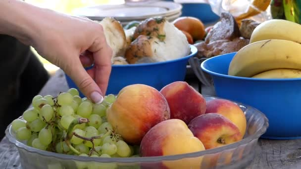 Prepare the Kitchen Table to Feast. Plates of Fruit, Meat, Vegetables, and Other Products.