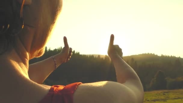 Woman Show Big Fingers - Like. Slow Motion at Sunset.