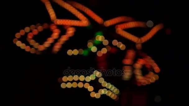 Circus Show: Led Light Clown on Stilts Dancing on a Night Street.