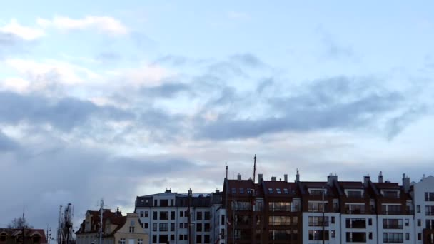 Grey and White Clouds Movibg Over European Multi Storey Buildings in Autumn in Slow Motion