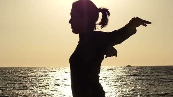 Woman Makes Warmup Before Training at Sunset in Slow Motion.